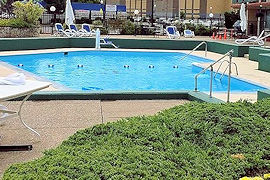 Outdoor Swimming Pool at The Genetti Hotel and Suites
